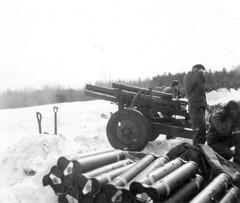 vehicle(0.0), tank(0.0), machine gun(0.0), firearm(0.0), gun(0.0), soldier(1.0), weapon(1.0), self-propelled artillery(1.0), gun turret(1.0), cannon(1.0), monochrome(1.0), military(1.0), black-and-white(1.0),