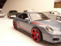 porsche 911 gt2(0.0), porsche 959(0.0), convertible(0.0), model car(1.0), automobile(1.0), automotive exterior(1.0), wheel(1.0), vehicle(1.0), automotive design(1.0), bumper(1.0), land vehicle(1.0), luxury vehicle(1.0), supercar(1.0), sports car(1.0),