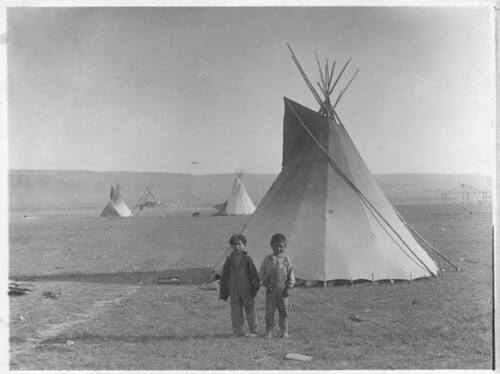 Image of Two Boys in Front of a Tipi from the National Archives