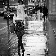 © Leanne Boulton, All Rights Reserved  Street candid taken in Glasgow, Scotland on a very blustery and showery day. I had been scouting out the best means of portraying the wind and this shot fell nicely into my lap when I saw her crossing the road with her hair flailing around in the gusts. Given t...