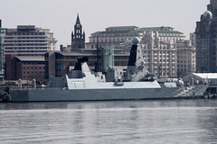 New Brighton Merseyside 8-March-2014 A view of the River Mersey from the Wirral side along Magazines Promanade Royal Navy Type 45 Destroyer D35 Liverpool HMS Dragon...