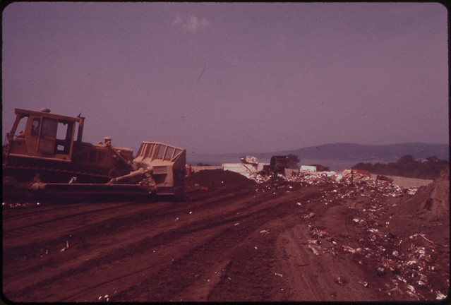 DOCUMERICA: Garbage Is Covered by One Foot of Earth in Croton Landfill Operation along the Hudson River 08/1973 by Wil Blanche.