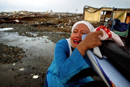 A woman weeps for the daughter she lost in the tsunami, Banda Aceh, January 2004