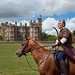 Horseback archer in front of the Elizabethan Englefield House in Berkshire