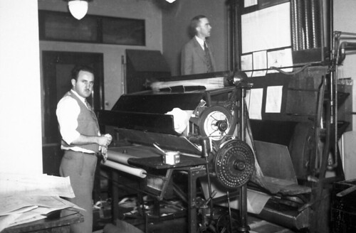 Men with printing press, circa 1930s