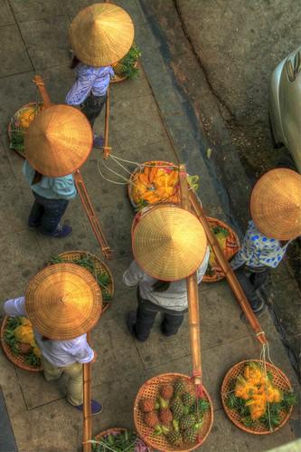 vendors on the streets of old quarter hanoi