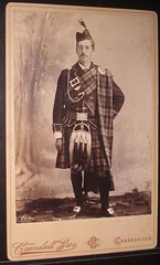Man in kilt with feathered cap Antique cabinet photo from victorian age