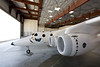 Vms Eve sits in the hangar preparing to be unveiled to the world. Mojave, July 08. Credit Herb Lingl