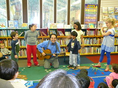 Playing the guitar and the flute with audience participation.