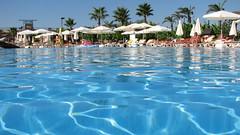 lagoon(0.0), swimming(0.0), sea(0.0), water park(0.0), resort town(1.0), swimming pool(1.0), leisure(1.0), resort(1.0),