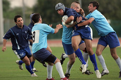 football(0.0), football player(1.0), ball(1.0), sports(1.0), rugby league(1.0), rugby union(1.0), rugby football(1.0), rugby player(1.0), team sport(1.0), tackle(1.0), player(1.0), rugby sevens(1.0), tournament(1.0), team(1.0),