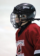 stick and ball games(0.0), football--equipment and supplies(0.0), football helmet(0.0), goaltender mask(0.0), goaltender(0.0), hockey protective equipment(1.0), clothing(1.0), sports(1.0), ice hockey(1.0), player(1.0), ice hockey position(1.0), athlete(1.0),