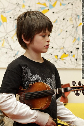 nick listening to rachel practice violin before breakfast