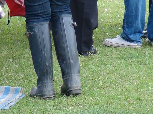 Woman in black Hunter wellies at a festival