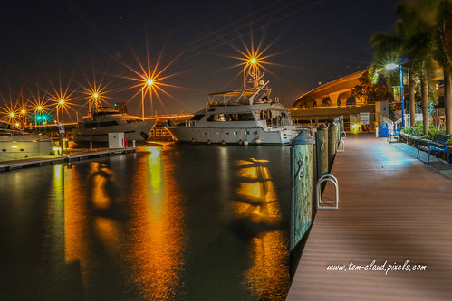 night nighttime waterfront water boat boats boardwalk lights sparkle sparkling starburst stuart florida usa outdoors outside bridge yacht yachts
