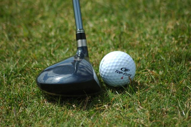 Golf Club Against Ball