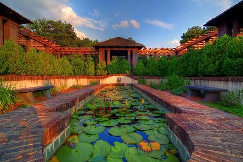 sunset house water fountain gardens clouds bench nc village lily lotus bricks tripod lion pad northcarolina hdr gitzo winstonsalem reynolda nymphaeaceae photomatix 5exposure nd06 ndx4 arcatech tokinaatx116prodx gt2531