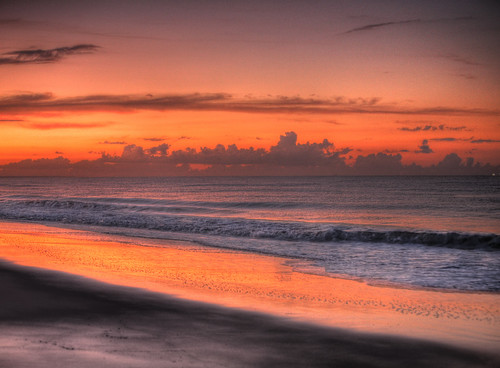 orange sun beach water sunrise sand waves glow northcarolina oakisland