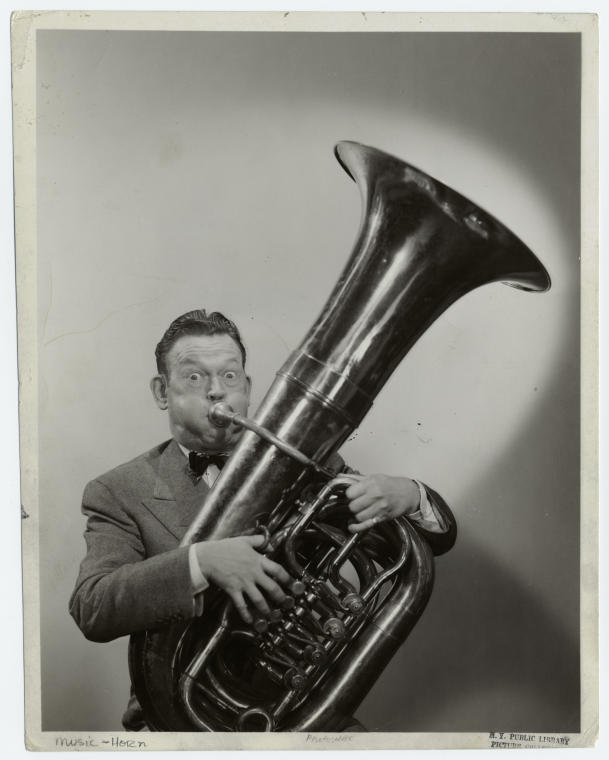 [Man playing the tuba.]