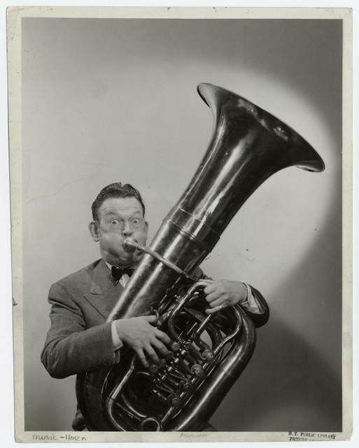 [Man playing the tuba.]
