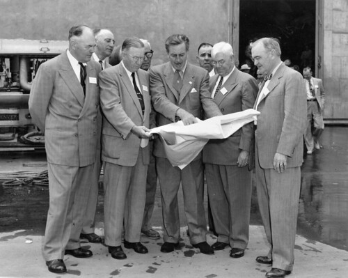 Walt Disney shows Disneyland plans to Orange County officials, Dec. 1954