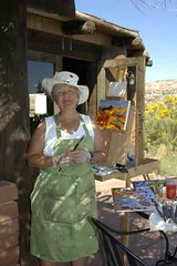 Nancy painting at the Kiva Koffee in Escalante, Utah