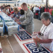 Volunteers pack care packages for troops