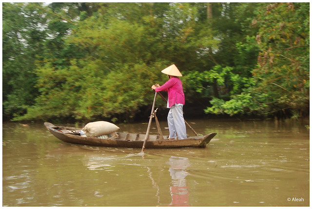 boat woman in the mekong river