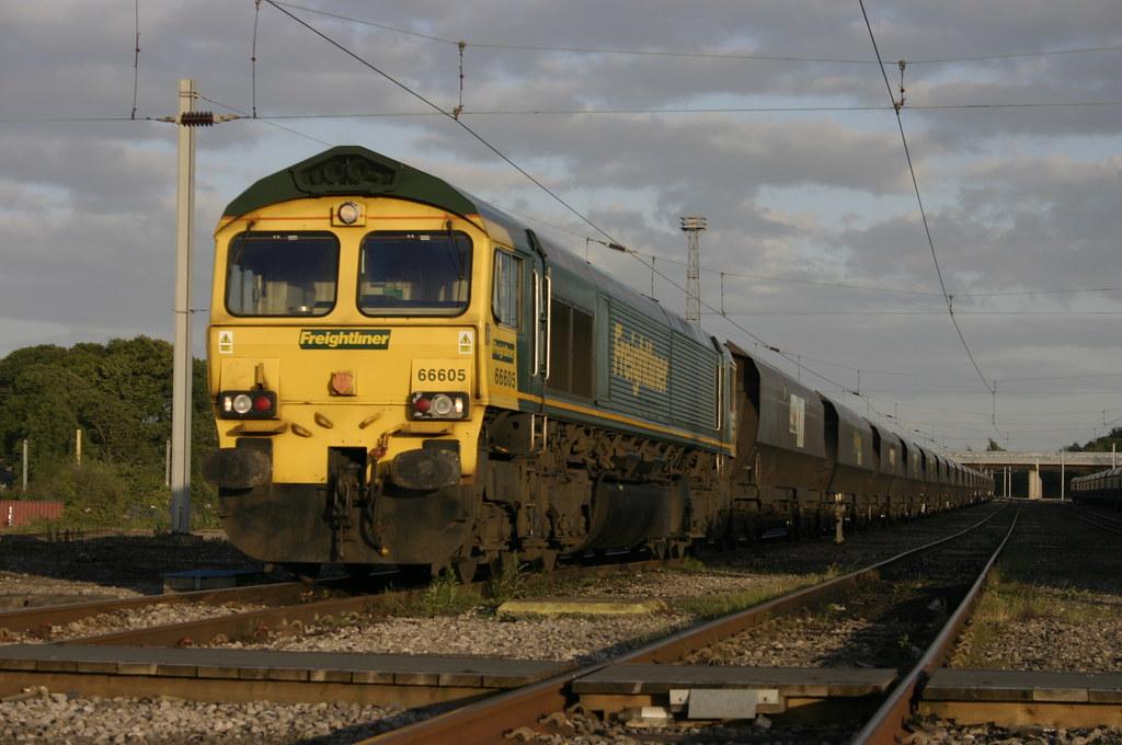 66 605 with 4S68 in Kingmoor Yard.