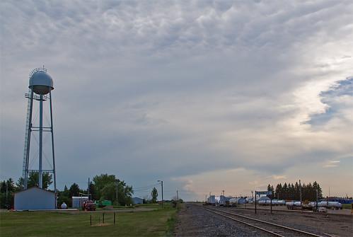 clouds watertower northdakota thunderstorm railroadtrack stationsign lignite dmvw westernsubdivision dakotamissourivalleywesternrailroad