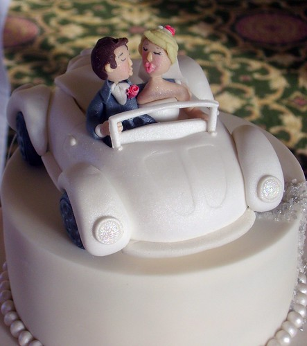 close up wedding cake topper