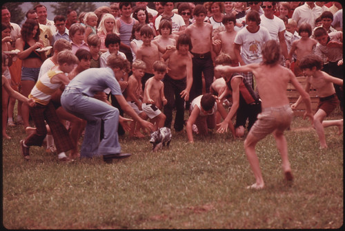 Anxious Youngsters Begin the Chase in a Greased Pig Contest at the Tennessee Consolidated Coal Company First Annual Picnic Held at a Tennessee Valley Authority Lake near Jasper and Chattanooga, Tennessee 08/1974