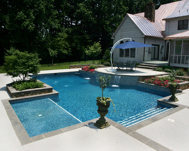 Rectangle wader tanning ledge this pool features a elite for Pool design with tanning ledge