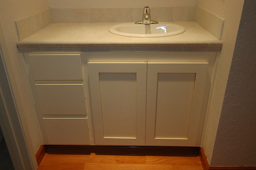 Custom design woodworks for Refacing bathroom cabinets cost