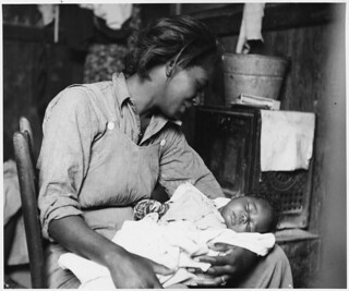 Migrant Cotton Picker and Her Baby near Buckeye, Maricopa County, Arizona