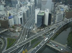 tower block, metropolitan area, highway, traffic, junction, bird's-eye view, transport, skyscraper, road, public transport, metropolis, urban area, lane, controlled-access highway, residential area, overpass, aerial photography, city, downtown, infrastructure, bridge, intersection,