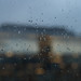 Small photo of The Palaestra building obscured by rain drops