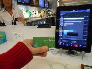 iPad iPad in airport bar, swipe payment