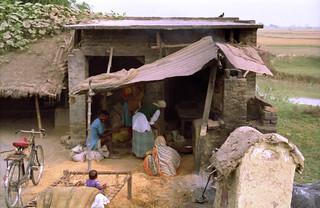A family's power shed, family farm, bike, pond, fields, Kusinara, Lumbini, India or Nepal in 1993