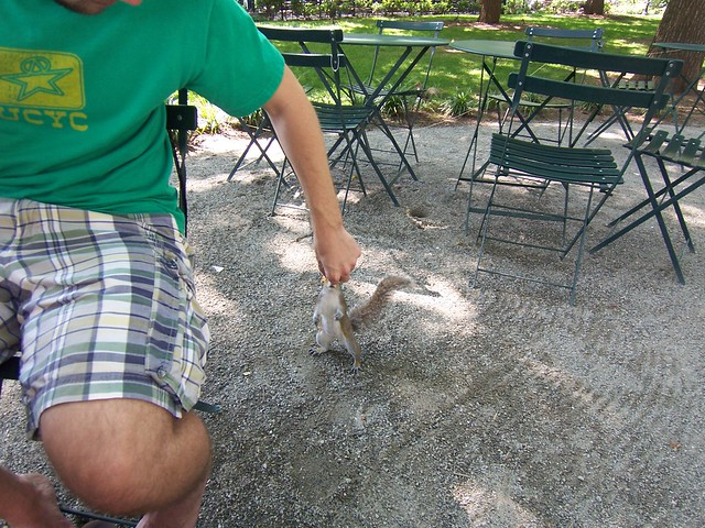 ian feeds bacon to a squirrel