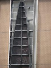 sash window(0.0), handrail(0.0), window covering(0.0), interior design(0.0), ladder(0.0), window(1.0), iron(1.0), facade(1.0),