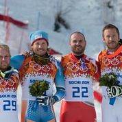 Jan Hudec stands on the podium with fellow super-G medalists at the Olympic winter games in Sochi, Russia