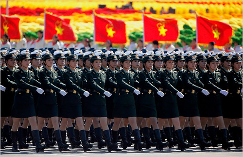Women in military formations representing the People's Liberation Army of the People's Republic of China during their national commemorations honoring the 60th anniversary of the socialist revolution of 1949. by Pan-African News Wire File Photos