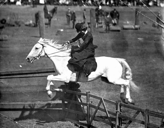 Horsewoman riding side-saddle jumping a fence at the Moonta Show