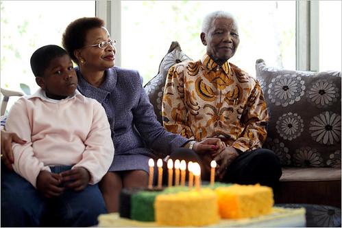 Former South African President and ANC leader Nelson Mandela along with his wife Graca Machel and his grandson. by Pan-African News Wire File Photos