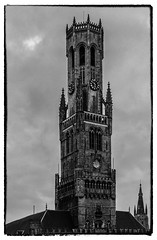 The Belfry (Market Square - Bruges) (Church Our lady in background) (BW) (Olympus OMD EM5II & Leica f1.4 25mm DG Summilux Prime)