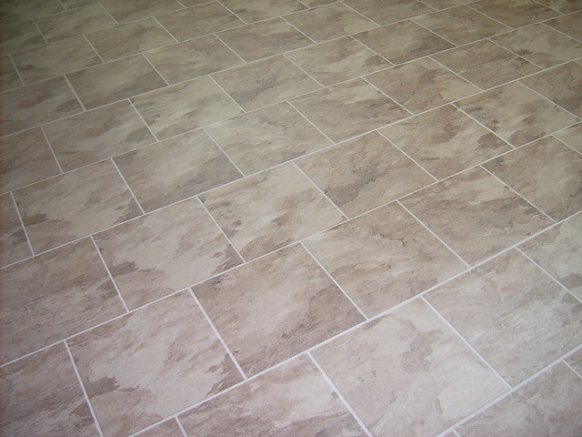 Laminate flooring ceramic tile look laminate flooring for Ceramic laminate flooring