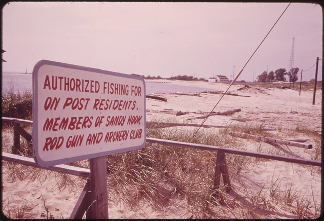 DOCUMERICA: Sign Outside Old Fort Hancock on Sandy Hook. New Plans Call for Careful Preservation of the Area and Its Beaches 05/1973 by Arthur Tress.