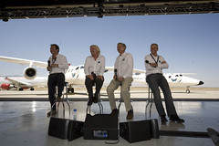 Virgin Galactic President Will Whitehorn, Sir Richard Branson, Burt Rutan and Virgin Galactic Commercial Directo Stephen Attenborough lead the VMS Eve Roll Out Press Conference. Credit Ned RocknRoll