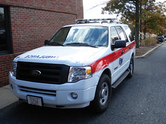 police(0.0), police car(0.0), automobile(1.0), automotive exterior(1.0), sport utility vehicle(1.0), vehicle(1.0), ford expedition(1.0), bumper(1.0), ford(1.0), land vehicle(1.0), motor vehicle(1.0),